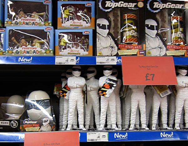 The Stig toy from TopGear on shelf