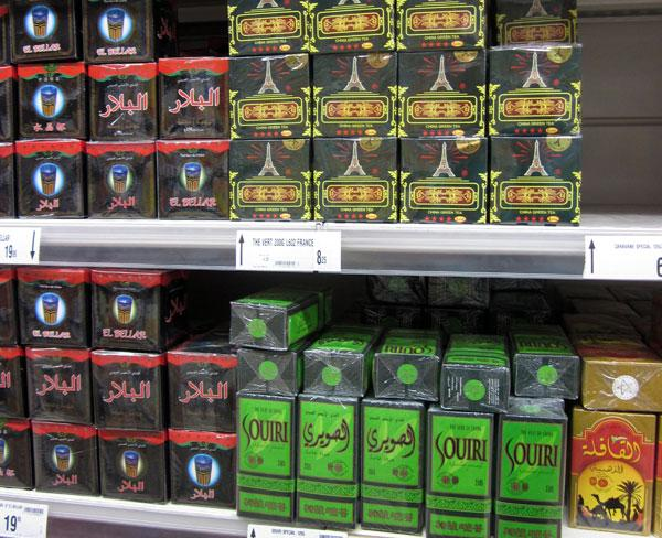Cube-shaped packs of leaf tea on a supermarket shelf in Marrakech