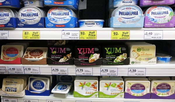 Several Cream Cheese Packaging on a Supermarket Shelf