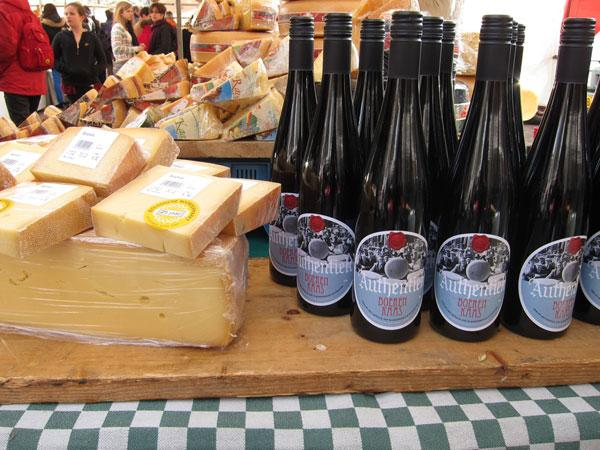 Cheese and wine bottles at the Farmer's market in Amsterdam