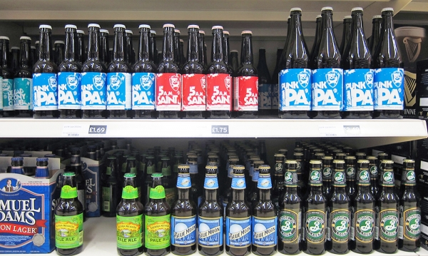 Several Beer Brands on a Supermarket Shelf