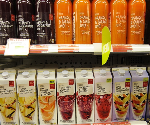 Fruit Juice Packages on a Supermarket shelf