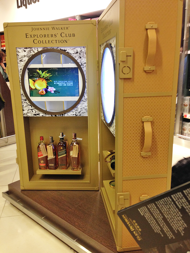 Johnnie Walker display at the airport simulating Louis Vuitton Luggage