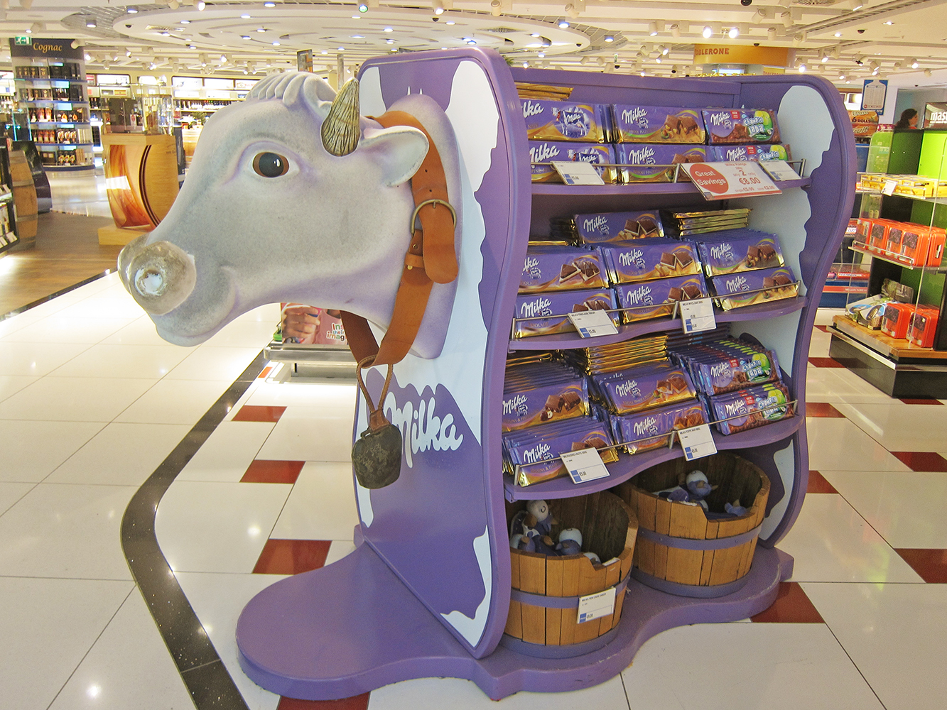 Milka Chocolate display at airport with purple cow shape