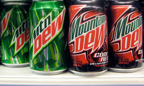 Mountain Dew soft drinks cans on shelf