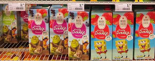 Fruit juice carton packages on shelf
