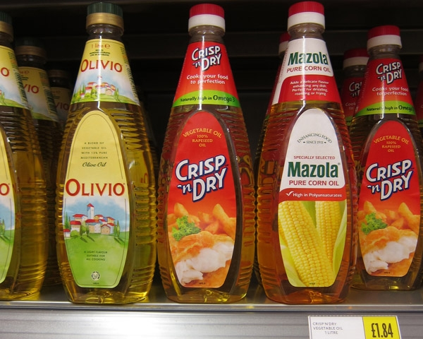 Several Vegetable Oil Bottles on Shelf
