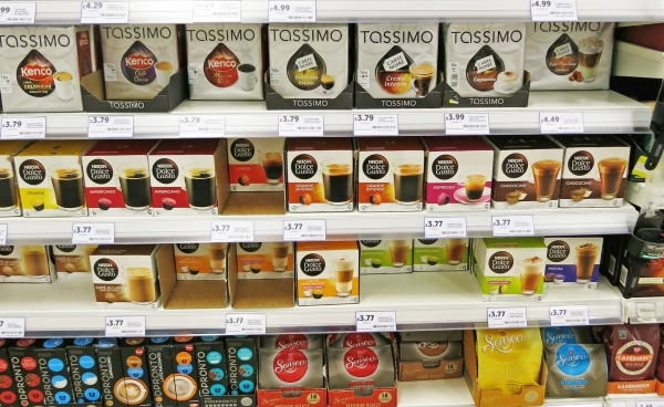 Several Coffee Pods Packages on a Supermarket Shelf