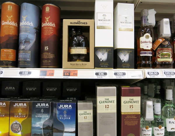 Several Whiskey Brands on a Supermarket Shelf