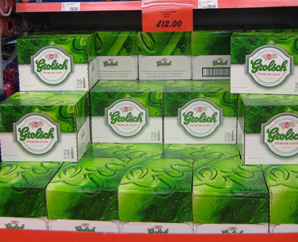 Grolsch beer boxes on a supermarket shelf