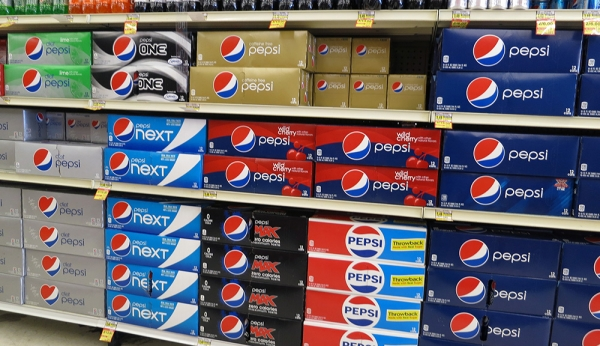Several Pepsi Packages on Shelf