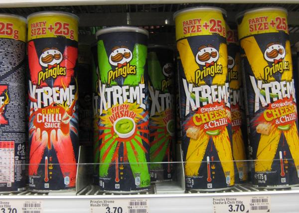 Several Pringles cans on a supermarket shelf