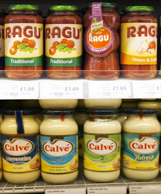 Calvé and Ragu sauce bottles on shelf