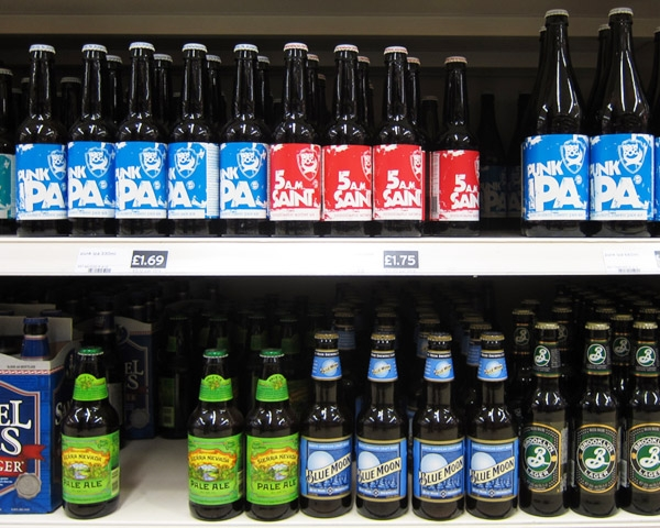 Beer Bottles on shelf focusing on Brew dog bottles with 70's reminiscences